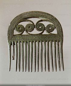 Ornamental bronze comb from the oak-coffin burial of a girl at Egtved near Kolding, Denmark. (See also 06-03-01/44, 45, 46) Ealry Bronze Age (1000 BCE)