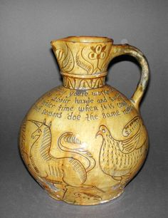 Jug, England, Devon, North Devon, dated 1703/4 Earthenware, the body thrown, slip-coated, and incised under lead glaze. Fitzwilliam Museum, Gl.C.58-1928