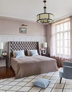 The master bedroom. Headboard, Thörmer. Armchair, Designers Guild. Lamps on bedside tables, Bella Figura.