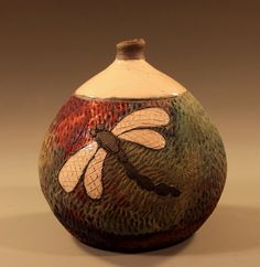 www.NitaClaise.com. Facebook: Pottery by Nita Claise