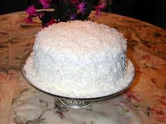 Paula and Jamie Deen Coconut cake. Make sure you refrigerate the cake for three days - that way the filling has a chance to seep into the cake, making it super moist and delicious :)
