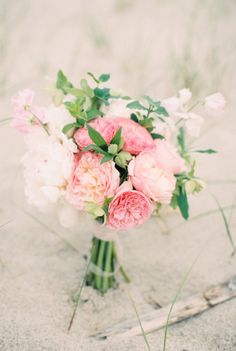 I like the texture of this bouquet. less medium pink, add creams and lilac of course but the shape is great!
