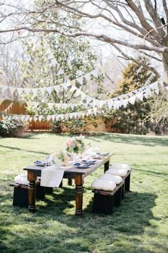 Lovely open space, yet private.  I love the streamers in the trees and the dappled shade and the cushions on the seats. :)