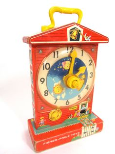 Vintage Fisher Price Musical Tick Tock Clock; My Grandmother has this at her house somehwere. I would love to have all the old wooden toys like this.