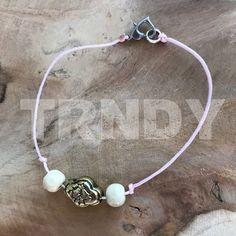 Roze armbandje met bijzondere kraal