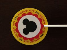 Cupcake toppers - Mickey Birthday theme, personalized backing. Toppers have 4 layers of quality card stock paper and is mounted with foam for a 3D look. 12 assembled toppers for $10, includes lollipop stick. For every 20 dollars in your order you will receive 50 black Mickey Mouse heads to use as confetti for tables, scrapbook decoration, embellishments, etc.