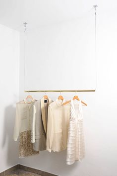 Brass Hanging Clothes Rack by AvelereDesign on Etsy https://www.etsy.com/listing/192883380/brass-hanging-clothes-rack