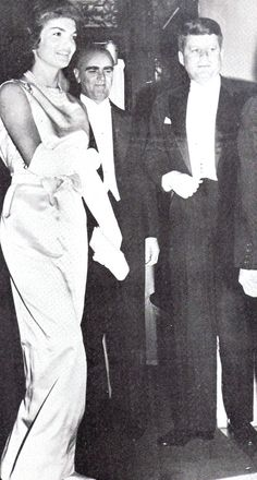 A simple white satin sheath gown was worn by Jacqueline Kennedy at a dinner party in the Greek Embassy hosted by Greece's Prime Minister Constantine Caramanlis, at center.  (Scan by jackieandaudrey from the magazine A Salute To Jacqueline Kennedy). ♡❤❤❤♡❤♡❤❤❤♡ http://en.wikipedia.org/wiki/Jacqueline_Kennedy_Onassis  http://en.wikipedia.org/wiki/John_F._Kennedy