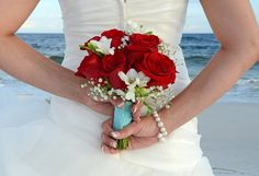 Classic red roses with Something Blue wrap.  Destin, FL photo by Sunset Beach Weddings.