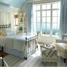 Comfy cozy cottage bedroom... love the idea of a painted ceiling instead of the walls.