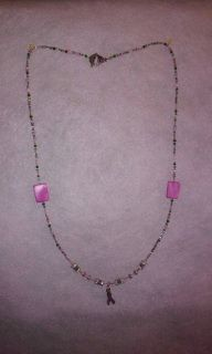 6d0dc5426 28 inch necklace with silver leaf motif toggle closure. A mixture of pink