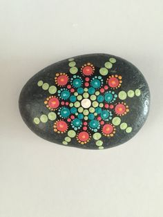A personal favorite from my Etsy shop https://www.etsy.com/listing/466283451/mandala-stone-hand-painted-rock-dot