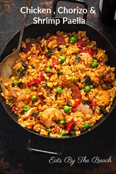 In the mood for some Spanish food? This Chicken Chorizo and Shrimp Paella recipe will redefine your romantic dinner dates and lunch parties with friends! Best Paella Recipe, Shrimp Paella Recipe, Spanish Paella Recipe, Seafood Paella, Chicken Paella Recipe Easy, Paella Food, Recipe Chicken, Seafood Recipes, Chicken Recipes