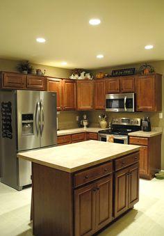 Recessed lighting in kitchen, living room, hallways, and bedrooms.