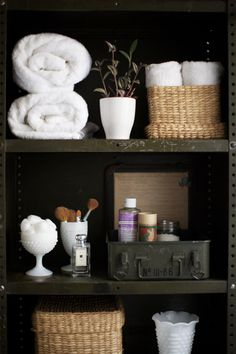 matching baskets.. open case for bath products.. white icecream glasses hold  makeup brushes, cotton balls and a potted plant