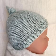 A quick and easy knit baby hat with sizes from preemie to 2 years.Instructions are given for both knitting flat and knitting in the round. Just choose whichever method you are most comfortable with.The top knot can be adjusted to make the hat shorter or longer in height - an invaluable advantage for newborns! No more baby photos with the hat falling over their eyes. I