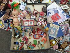 Assorted toys including a Kewpie doll at Tokyo flea market
