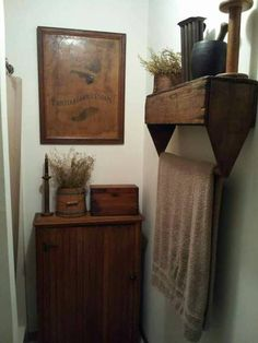 Love this primitive tool box used as a towel rack!