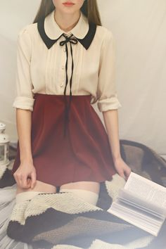 .love this blouse...I couldn't pull of that skirt with my muffin top though lol