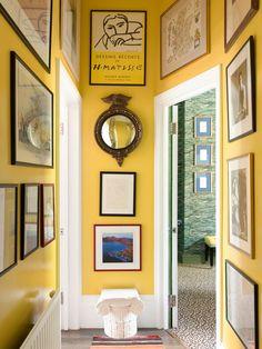 inside Luke Edward Hall's maximalist London apartment: yellow hallway / gallery wall hallway ideas