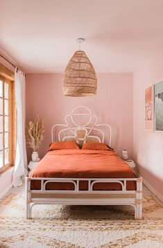 Japanese Apartment Decor pink bedroom with white rattan bed and orange rust bedding and large woven hanging lighting fixture. Home Bedroom, Modern Bedroom, Bedroom Furniture, Bedroom Red, Master Bedroom, Contemporary Bedroom, Bedroom Suites, Coral Bedroom Decor, Burnt Orange Bedroom