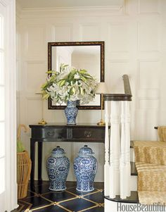 "An Elegant Foyer - A black floor painted to look like marquetry is ""elegant without being too fancy"" by designer Ashley Whittaker - Decorating Foyers with Furniture and Color  - House Beautiful"