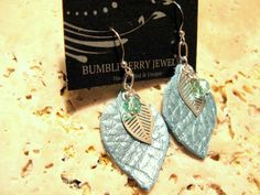 Turquoise, Teal Leather & Sterling Silver Leaf Earrings with Turquoise Crystal. $20.00, via Etsy. #leatherjewelry,  #leatherearrings