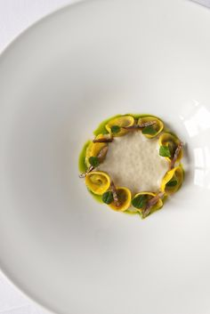 In this striking starter by Norbert Niederkofler, ravioli is stuffed with chard and served with sliced sardine fillets, chervil oil and a rich bacon foam. To make the bacon foam, the chef gently infuses bacon, cream and herbs in a water bath over 8 hours, then uses a siphon gun to create a light, delicate foam.