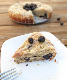 Moist Blueberry Muffin Cake. A super delicious cake that is perfect for a weekend morning breakfast! Loaded with blueberries, and covered in vanilla glaze and crumb topping.
