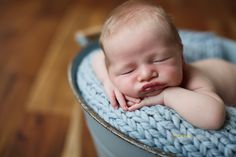 This sweet boy slept perfectly for his session. He has such gorgeous lips and I love his cheeks! I had a lot of fun (while mommy, daddy, and I all drenched with sweat because the heat outside made my studio far too hot!) posing him. I hope they love this sneak…