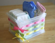 Decorate Plastic Baskets for Attractive Storage - 150 Dollar Store Organizing Ideas and Projects for the Entire Home - This would be a cute baby shower gift. or a good little diaper station if you have an upstairs and a downstairs Dollar Store Bins, Dollar Store Crafts, Dollar Stores, Thrift Stores, Plastic Baskets, Gift Baskets, Plastic Tables, Plastic Storage, Craft Gifts