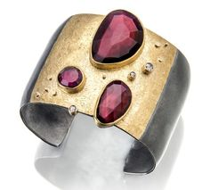 "Sydney Lynch | ""Rhodolite cuff""; rose-cut rhodolites, rose-cut champagne diamonds, 18k & 22k gold, oxidized silver. Bracelet argent et or avec rhodolites et diamants."