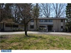 Penn Valley brick mid-century modern on 2.2 level acres in Penn Valley with tennis court.  6 BR, 4.5 BA, 4654 Sq Ft.  $899,500