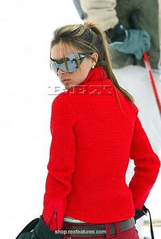 This looks like a red version of the pullover she was wearing in a different picture.