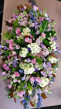 Pastel with a touch of blue. Casket Flowers, Funeral Flowers, Casket Sprays, Funeral Arrangements, Sympathy Flowers, Floral Wreath, Pastel, Wreaths, Touch