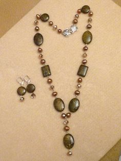 OOAK design by Margica.<br><br>*This jewelry set is wired in silver. <br><br>*Bronzite is paired with beautiful gold freshwater pearls, and gold champagne crystals.<br><br>*These crystals are fine fire-polished czech crystals which give them that extra sparkle!<br><br>*Earrings are light. They are 1 1/2 inch long. ...