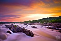 The waters of the Potomac River pour through Great Falls at sunrise.