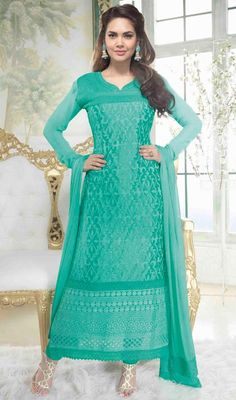 Keep your admirers spellbound like Lisa Haydon arrayed in this aqua blue chiffon long churidar suit. Beautified with lace and resham work. #AquaBlueCottanLaceAnkleSuit