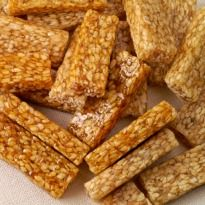 Til ki Chikki: A crunchy snack made with sesame seeds and sugar, perfect to satisfy your mid-meal cravings.