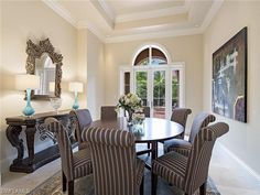 Formal dining room with round table for eight | Osprey Trail in Estuary at Grey Oaks | Naples, Florida