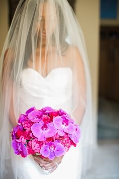 A striking bridal bouquet features vibrant purple orchids. #orchids #bouquet Photography: Erik Umphery. Read More: http://www.insideweddings.com/weddings/a-radiant-orchid-malibu-wedding-with-an-ocean-view/604/