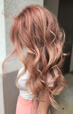 rose gold hair. extensions. wavy hair.
