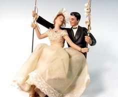 """Vintage Bride Groom Swinging/ Cake Topper Doll Figures-- Composition.They measure approx. approx. 7"""", head to toe with the total height counting the wire swing at 9 1/2"""" tall and 5"""" wide.  
