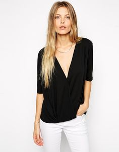 ASOS Crepe Wrap Front Top  As seen on Eleanor Calder in her Instagram photo posted on March 8, 2015
