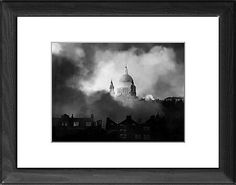 22x18 (56x46cm) Framed Print featuring WWII air raid fire Smoke and flames, from an air raid fire, surrounding St Pauls Cathedral, London, UK, on Sunday 29 December 1940 during the Second World War (1939-1945) This photograph is from the archives of the New York Times. Wood grain effect frame with professionally mounted print. Overall outside dimensions are 22x18 inch (566x465mm). Features hardboard back stapled in with hanger and glazed with durable Styrene Plastic to provide a virtually…
