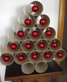 Cardboard rolls Christmas tree - paint the rolls green? For the office perhaps