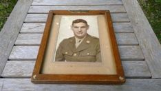 Vintage WW2 Wood Framed Soldier Portrait Photo with Military Eagle. The sun light is reflecting on the glass in the shown pictures. The frame is App 8 x 10 Inches in thick old wood and holds the portrait frame of a soldier with three stripes. The Frame has a military eagle in the top center in Postcard Album, Hollywood Actress Photos, Frame Gallery, Vintage Picture Frames, Sun Light, Metal Stars, Antique Photos, Old Wood, Black Decor