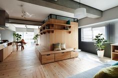 Modern Apartment With An L-Shaped Wooden Wall