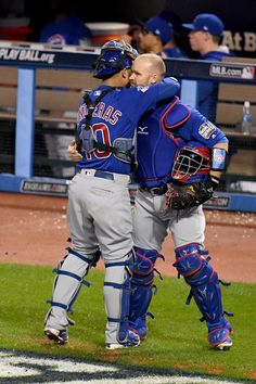 Willson Contreras #40 of the Chicago Cubs hugs teammate David Ross #3 during Game Seven of the 2016 World Series against the Cleveland Indians at Progressive Field on November 2, 2016 in Cleveland, Ohio.