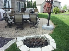 Backyard! Really like the small fire pit and stone patio